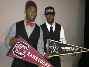 Skai Moore, left, and Jordan Cunningham pose for a photo after National Signing Day on Feb. 6, 2013 at Davie University School.