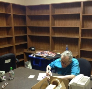 Miami Herald columnist Edwin Pope sits at his desk after emptying out his office in Miami on April 6, 2013.